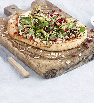 Courgette flatbreads with garlic yogurt and pomegranate