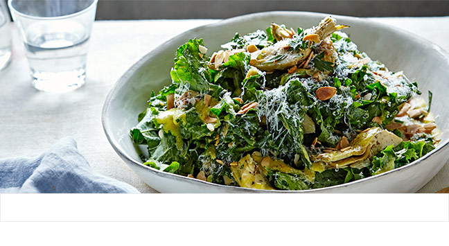 Kale salad with anchovy dressing, artichokes and pecorino