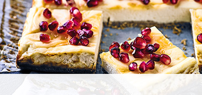Baked orange and pomegranate cheesecake bars