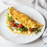 Garlic & herb omelette with roasted tomatoes