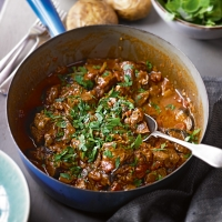 Lamb, tomato and anchovy casserole with cumin aubergines