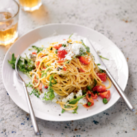 Spaghetti with goat's cheese, rocket & peas