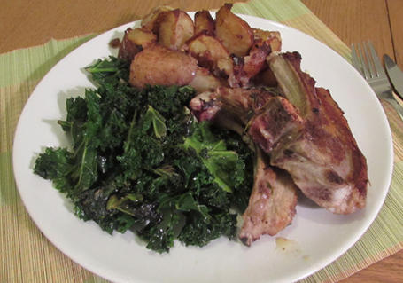 Lamb cutlets with kale and herby roast potatoes