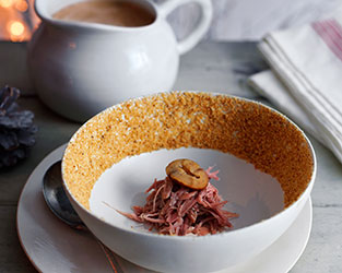 Heston's mushroom and chestnut veloute with confit duck