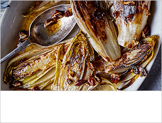 Roast chicory bulbs with honey, cider and pecans
