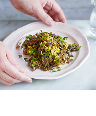 Brown rice pilaf with mushrooms, caramelised onions and yogurt