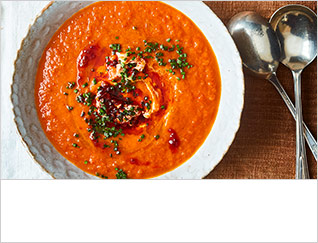 Tomato, red pepper & sweet potato soup with harissa yogurt