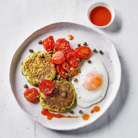 Courgette fritters, roasted tomatoes & eggs