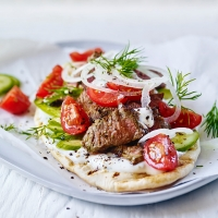 Lamb gyros with tomato salad and garlic yogurt