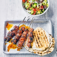Oregano-marinated chicken kebabs with Greek salad & wraps