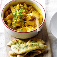 Potato & cauliflower curry with garlic naan wedges