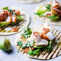 Spiced fish tortillas with burnt chilli sauce, avocado & coriander