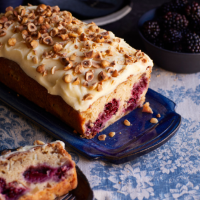 Apple and blackberry loaf with clotted cream icing