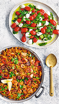 Tomato and mozzarella salad, and smoky paella
