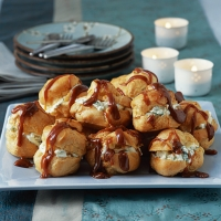 Toffee profiteroles with pineapple and basil cream
